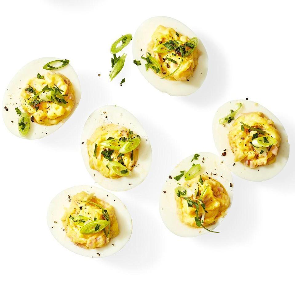 """<p>These spicy deviled eggs are perfect for spice lovers. For added flavor and protein, mix in some chopped ham or bacon. </p><p><strong><em><a href=""""https://www.womansday.com/food-recipes/a31977676/spicy-deviled-eggs-recipe/"""" rel=""""nofollow noopener"""" target=""""_blank"""" data-ylk=""""slk:Get the Spicy Deviled Eggs recipe."""" class=""""link rapid-noclick-resp"""">Get the Spicy Deviled Eggs recipe. </a></em></strong></p>"""