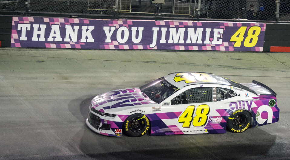 Jimmie Johnson drives past a banner on the wall at the entrance of turn three during a NASCAR Cup Series auto race at Bristol Motor Speedway in Bristol, Tenn. NASCAR's nicest guy will run his final race this week and close a remarkable career. Jimmie Johnson's record-tying seven Cup titles are well celebrated, but his charitable work goes less noticed. The Jimmie Johnson Foundation has donated more than $12 million to schools and programs since it launched. (David Crigger/Bristol Herald Courier via AP)