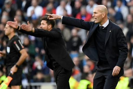 Making the point: Zinedine Zidane won the coaching battle with Atletico's Diego Simeone in the Madrid derby