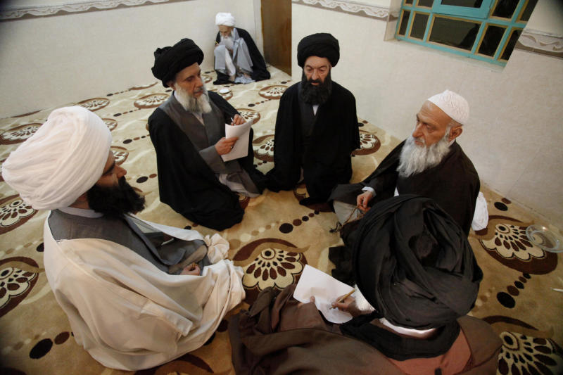 In this picture taken on Feb. 21, 2012, wax figures depicting Shiite clerics are on display at the wax museum in the Shiite holy city of Najaf, 100 miles (160 kilometers) south of Baghdad, Iraq. What was intended to be a tribute to this Shiite holy city's contributions to culture has instead given critics the opportunity to, well, wax lyrical about what they call the project's faults instead.  (AP Photo/Alaa al-Marjani)