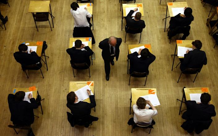 """a general view of pupils sitting an exam. The Government should consider holding rigorous """"backup"""" assessments rather than mock exams in case next year's GCSE and A-level exams are cancelled amid the pandemic, a think tank has suggested - PA"""