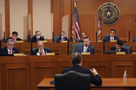 ADDS NAME Curtis Morgan, the CEO of Vistra Corp., at table, testifies as the Committees on State Affairs and Energy Resources holds a joint public hearing to consider the factors that led to statewide electrical blackouts, Thursday, Feb. 25, 2021, in Austin, Texas. The hearings were the first in Texas since a blackout that was one of the worst in U.S. history, leaving more than 4 million customers without power and heat in subfreezing temperatures. (AP Photo/Eric Gay)