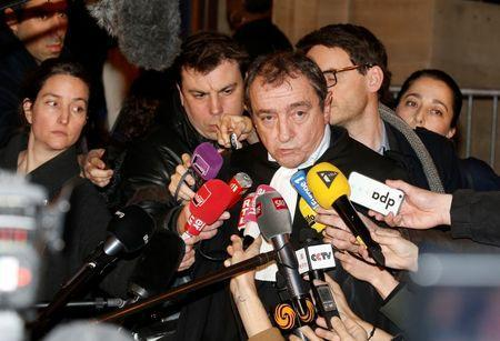 Patrick Maisonneuve (C), lawyer of International Monetary Fund (IMF) Managing Director Christine Lagarde, talks to journalists after the verdict in Lagarde's trial about a state payout in 2008 to a French businessman in Paris, France, December 19, 2016. REUTERS/Jacky Naegelen