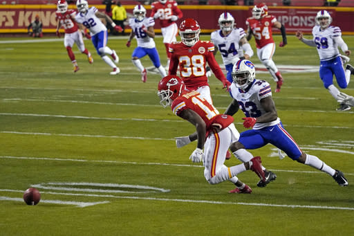 Kansas City Chiefs wide receiver Mecole Hardman (17) fumbles a punt in front of Buffalo Bills cornerback Siran Neal (33) during the first half of the AFC championship NFL football game, Sunday, Jan. 24, 2021, in Kansas City, Mo. Buffalo recovered the fumble. (AP Photo/Jeff Roberson)