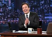 """This Feb. 21, 2013 photo released by NBC shows Jimmy Fallon, host of """"Late Night with Jimmy Fallon,"""" on the set in New York. A study released Monday of gags made by late-night comics found that Obama and Democrats provided the lion's share of punchlines during the first six months of the year. That's an abrupt change from 2012, when Mitt Romney proved a gift to the comic gods. (AP Photo/NBC, Lloyd Bishop, File)"""