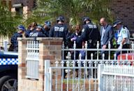 Forensic experts collect evidence from a house in the Guildford area of Sydney on September 18, 2014 (AFP Photo/Saeed Khan)