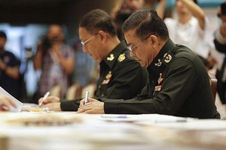 Newly appointed National Legislative Assembly members sign documents during a registration session at the Parliament House in Bangkok August 1, 2014. REUTERS/Athit Perawongmetha