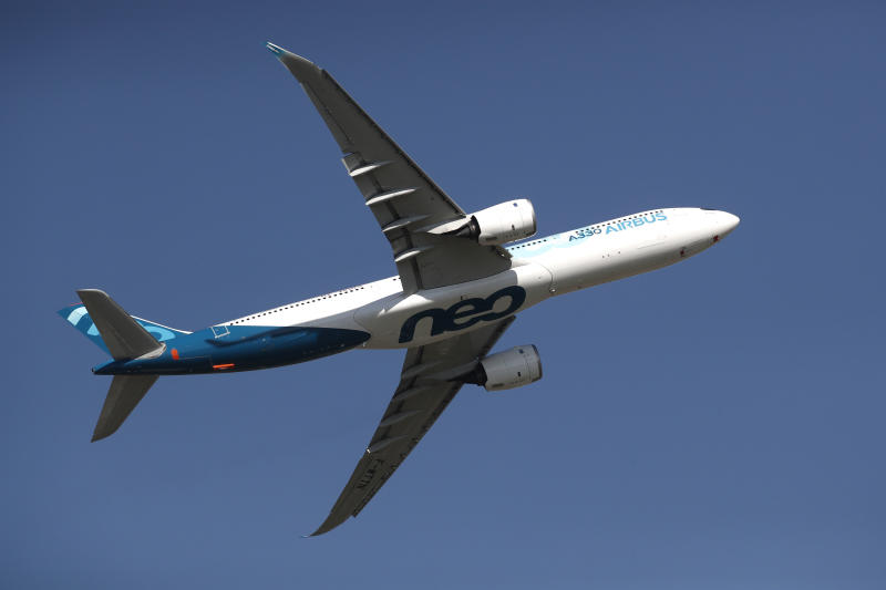 An Airbus A330neo aircraft performs during the inauguration the 53rd International Paris Air Show at Le Bourget Airport near Paris, France, Monday June 17, 2019. The world's aviation elite are gathering at the Paris Air Show with safety concerns on many minds after two crashes of the popular Boeing 737 Max. (Benoit Tessier/Pool via AP)