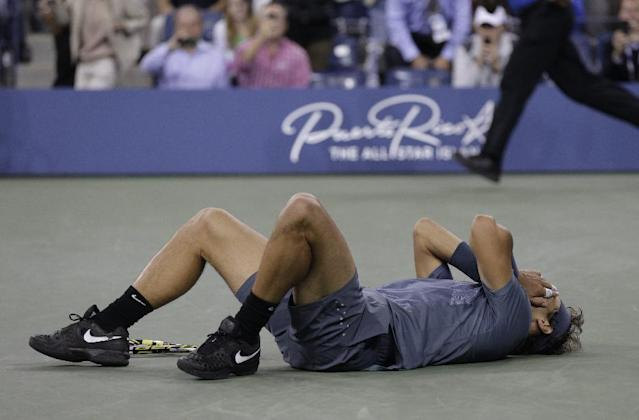 Rafael Nadal, of Spain, lays on the court after defeating Novak Djokovic, of Serbia, during the men's singles final of the 2013 U.S. Open tennis tournament, Monday, Sept. 9, 2013, in New York. (AP Photo/Peter Morgan)