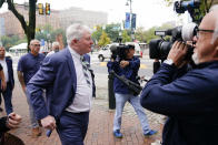 """Johnny """"Doc"""" Dougherty walks to the federal courthouse in Philadelphia, Tuesday, Oct. 5, 2021, to face charges in his corruption trial. (AP Photo/Matt Rourke)"""