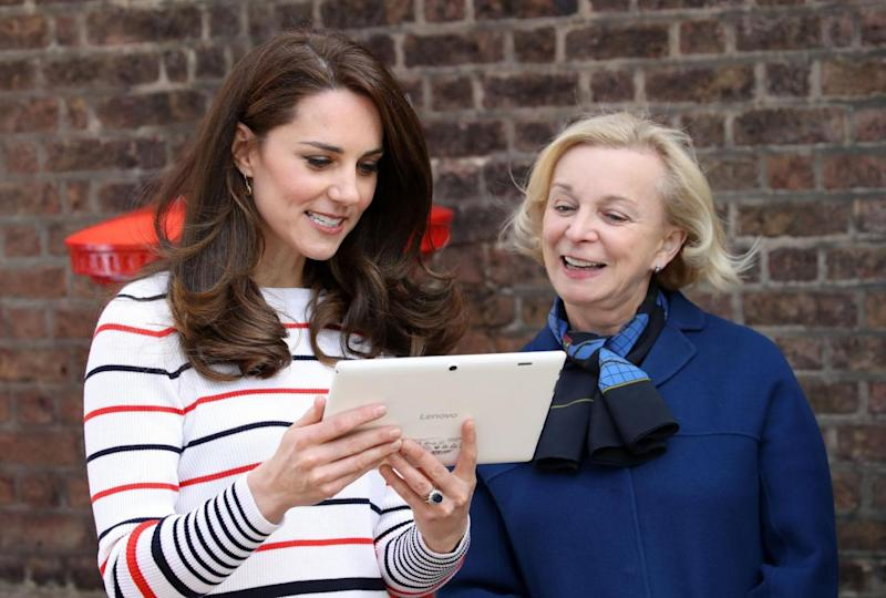 Kate speaks with Royal Mail CEO Moya Greene (PA)