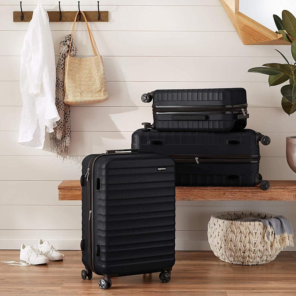<p>The scratch-resistant finish and expandable design make the <span>AmazonBasics Hardside Spinner Luggage</span> ($56) not a want, but a need. </p>