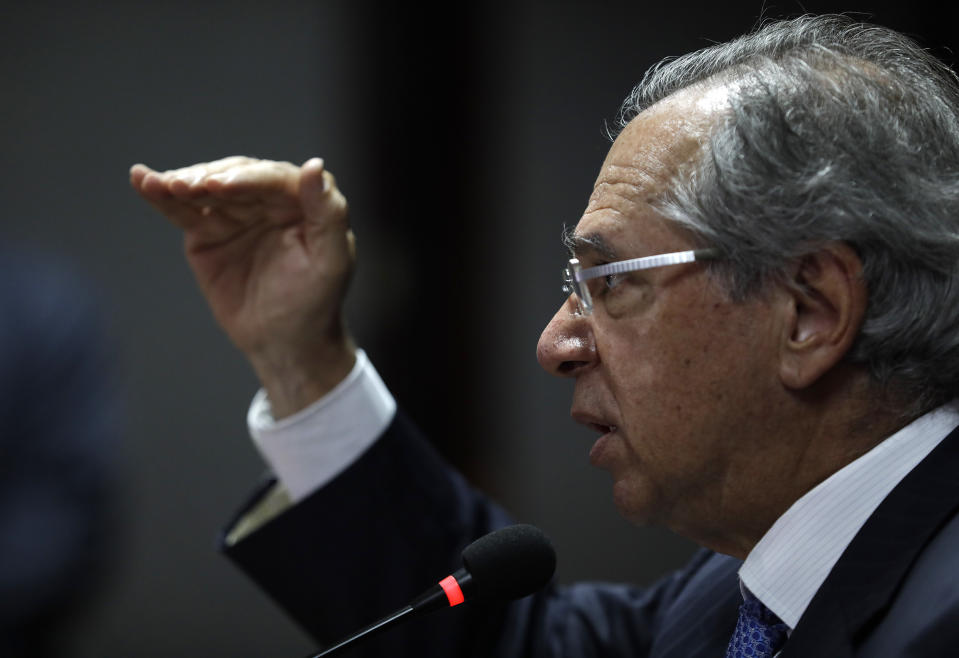Economy Minister Paulo Guedes talks with the foreign media in Rio de Janeiro, Brazil, Friday, Sept. 13, 2019. Guedes said that the Brazilian economy might start to pick up on 2022 when President Bolsonaro leaves office. (AP Photo/Silvia Izquierdo)