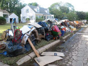This Friday, Sept. 3, 2021 photo shows ruined household possessions at the curb in Manville N.J. two days after the remnants of Tropical Storm Ida caused massive flooding in the New Jersey town near the Raritan River. (AP Photo/Wayne Parry)