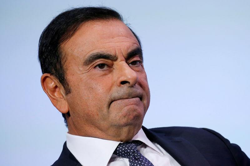 FILE PHOTO - Carlos Ghosn, chairman and CEO of the Renault-Nissan-Mitsubishi Alliance, attends at the Tomorrow In Motion event on the eve of press day at the Paris Auto Show, in Paris