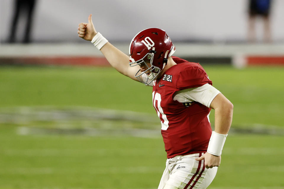 MIAMI GARDENS, FLORIDA - JANUARY 11: Mac Jones #10 of the Alabama Crimson Tide gestures to the fans as he heads off the field during the fourth quarter of the College Football Playoff National Championship game against the Ohio State Buckeyes at Hard Rock Stadium on January 11, 2021 in Miami Gardens, Florida. (Photo by Sam Greenwood/Getty Images)