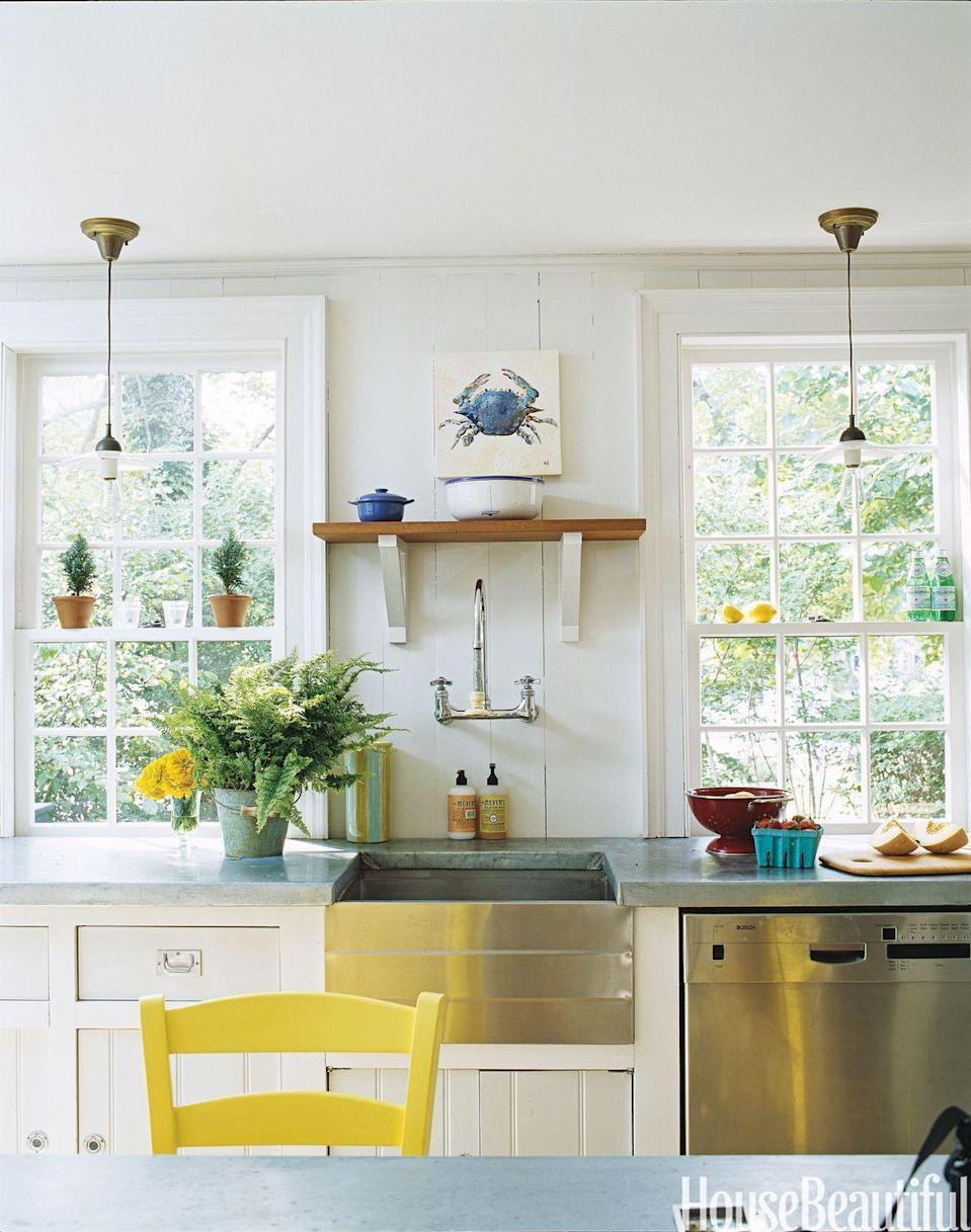 "<p>This kitchen has old pendant <a href=""https://www.housebeautiful.com/room-decorating/kitchens/tips/g1614/kitchen-lighting-ideas-0609/"" rel=""nofollow noopener"" target=""_blank"" data-ylk=""slk:light fixtures"" class=""link rapid-noclick-resp"">light fixtures</a>, zinc countertops, and antique chairs. It creates a modern atmosphere with vintage charm that feels very family-friendly and homey. </p>"