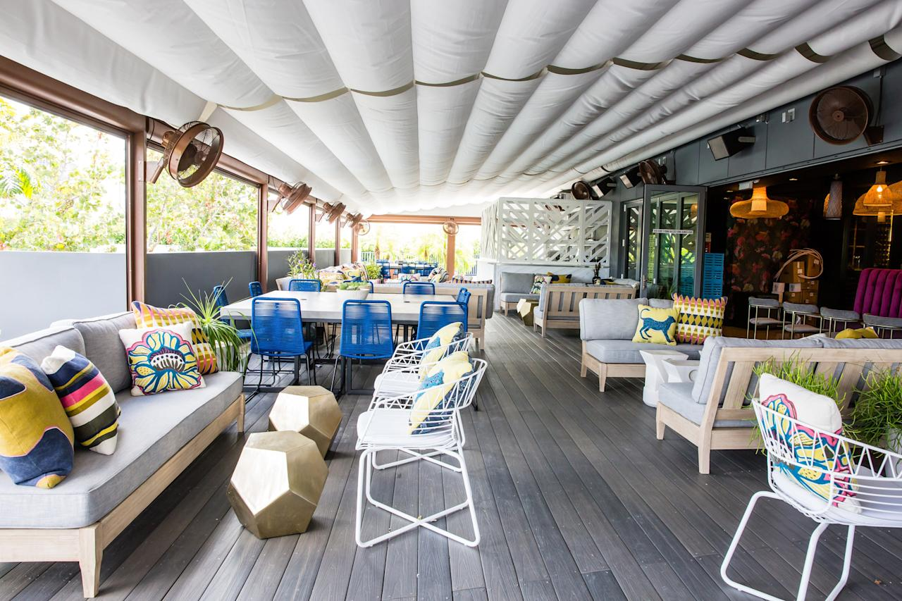 <p><strong>What struck you when you first arrived?</strong><br> This rooftop bar in the Wynwood Arcade is the first one of its kind. Live music, a modern tiki bar design, and excellent bar bites round out the cozy vibe.</p> <p><strong>So who's there?</strong><br> The crowd is a mix of Wynwood regulars and out-of-towners looking to soak up some of the artsy street art vibe.</p> <p><strong>How are the drinks?</strong><br> The drinks are for people serious about their cocktails, with concoctions like the Secret Beauty which blends vodka with collagen, egg white and blueberry or the Piña del sur which is made with pisco, house made creme de coco, pineapple, sage, lime and allspice. If you are not in the mood for a mixed drink, New York City wine expert Heidi Turzyn has pulled together a comprehensive list of labels to choose from, plus a nice line up of craft beers.</p> <p><strong>Worth ordering something to eat, too?</strong><br> The food menu is a bit different than similarly situated bars: You can snack on fried chicken bao, shrimp buns and tropical tuber chips.</p> <p><strong>How did you find the staff?</strong><br> They're attentive and take their work seriously. They also seem to enjoy what they are doing.</p> <p><strong>Wrap it up: what are we coming here for?</strong><br> Since rooftop bars are sadly rare in Miami (and even rarer in Wynwood) this spot stands out for its unique al fresco vibe.</p>