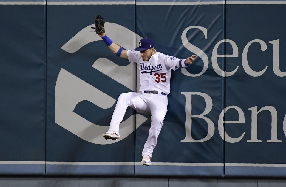 Los Angeles Dodgers right fielder Cody Bellinger hits the wall as he catches a ball hit by Tyler Austin during the sixth inning of a baseball game Tuesday, June 18, 2019, in Los Angeles. (AP Photo/Mark J. Terrill)