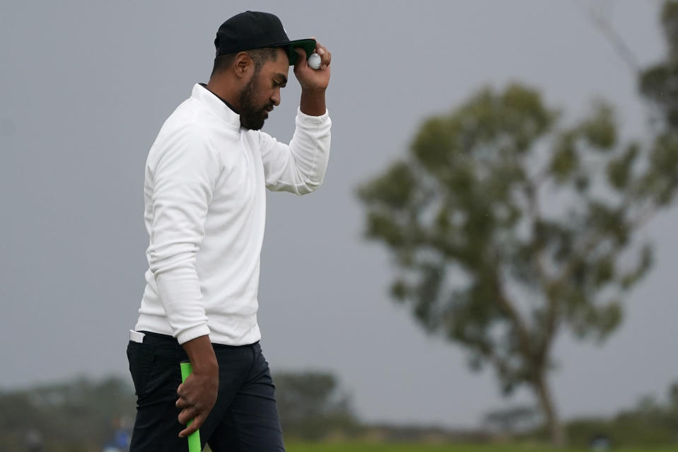 Tony Finau reacts after finishing on the 18th green of the North Course during the second round of the Farmers Insurance Open golf tournament at Torrey Pines, Friday, Jan. 29, 2021, in San Diego. (AP Photo/Gregory Bull)