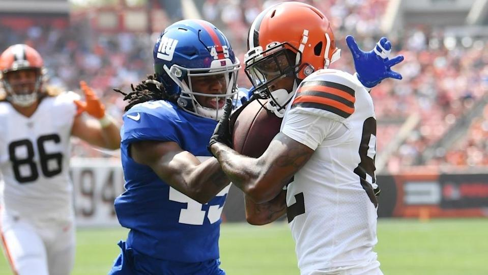 Aug 22, 2021; Cleveland, Ohio, USA; New York Giants cornerback Madre Harper (45) knocks the ball from Cleveland Browns wide receiver Rashard Higgins (82) during the first quarter at FirstEnergy Stadium.