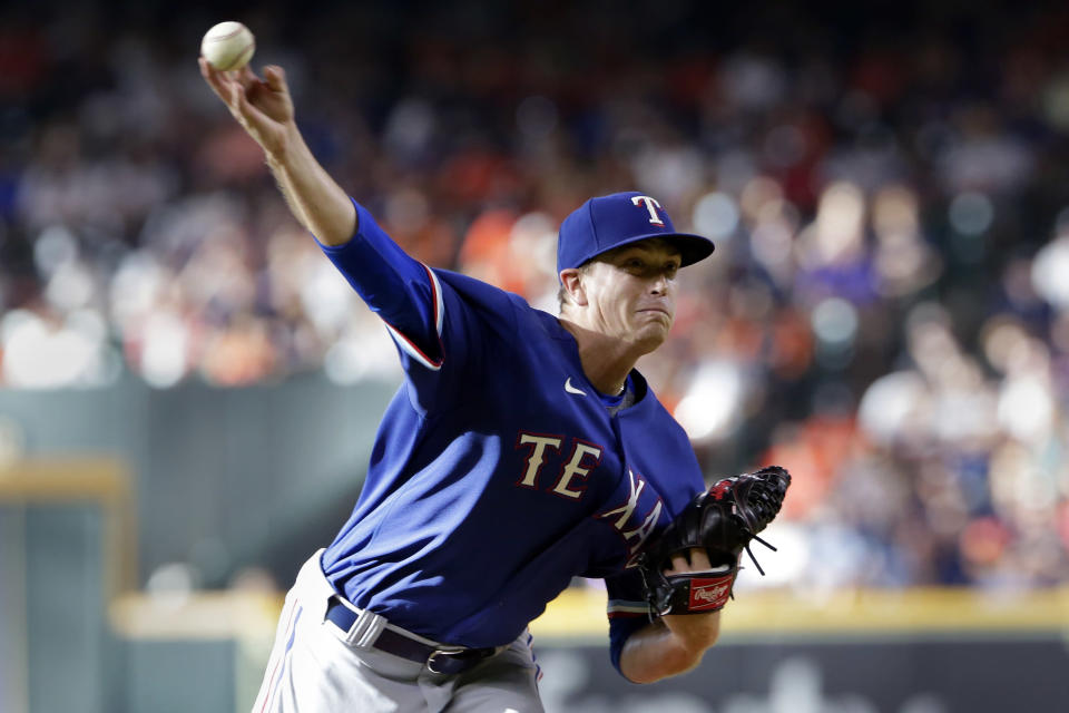 Texas Rangers starting pitcher Kyle Gibson throws to a Houston Astros batter during the first inning of a baseball game Saturday, July 24, 2021, in Houston. (AP Photo/Michael Wyke)