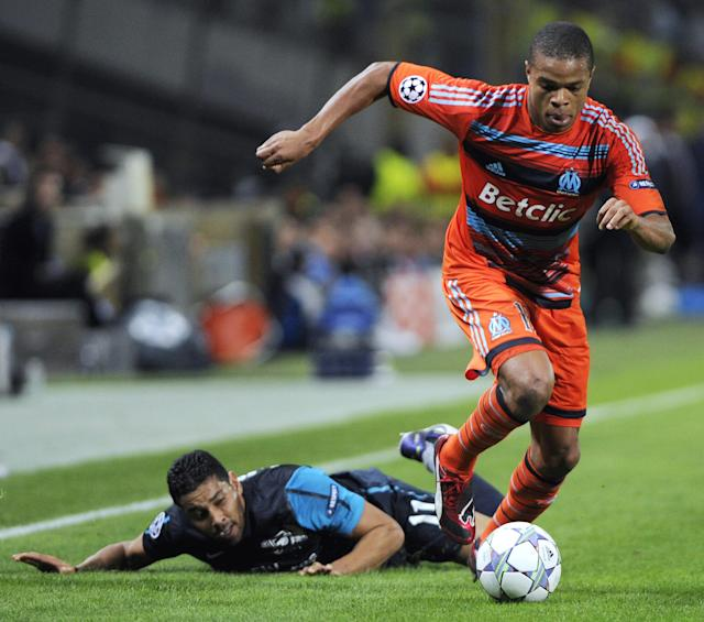 Arsenal's Brazilian player Andre Santos (L) vies with Marseille's French forward Loic Remy, on October 19, 2011 at the Velodrome stadium in Marseille, southern France, during the UEFA Champions League football match Marseille vs. Arsenal. AFP PHOTO / ANNE-CHRISTINE POUJOULAT (Photo credit should read ANNE-CHRISTINE POUJOULAT/AFP/Getty Images)