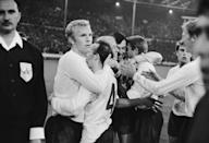 Captain Bobby Moore celebrating with his England team mates (Nobby Stiles, Bobby Charlton, Gordon Banks, Roger Hunt, Martin Peters and Jack Charlton) after their 2-1 victory over Portugal in the 1966 World Cup semi final at Wembley 27th July 1966. (Photo by Central Press/Hulton Archive/Getty Images)