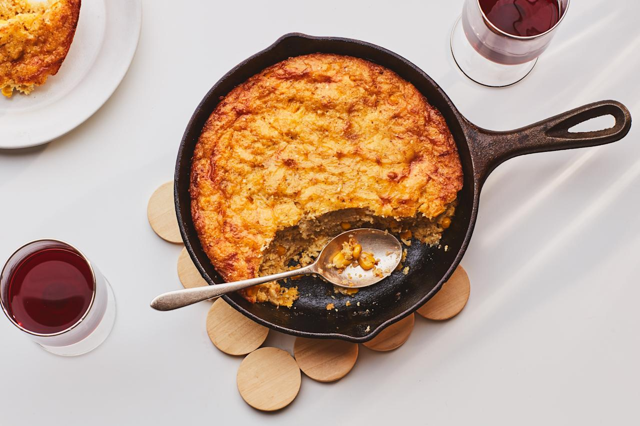 "Serve this creamy and garlicky spoon bread hot out of the oven for a cozy cold-weather side. <a href=""https://www.epicurious.com/recipes/food/views/cheesy-corn-spoon-bread?mbid=synd_yahoo_rss"">See recipe.</a>"
