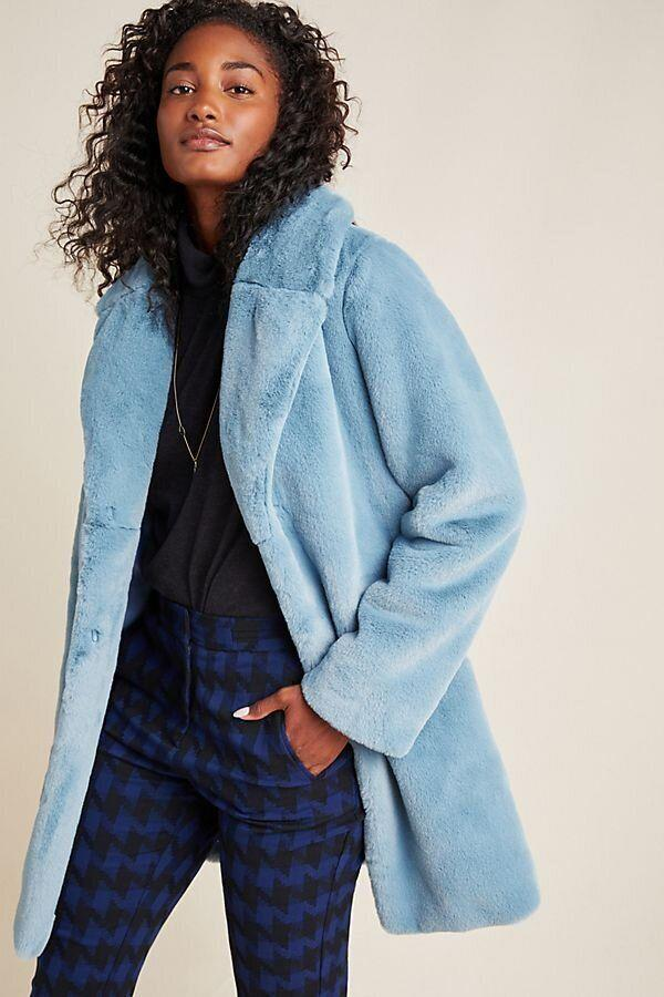 "This blue teddy coat has a hook-and-eye closure and pockets. <strong><a href=""https://fave.co/2UIT2kS"" target=""_blank"" rel=""noopener noreferrer"">Find it for $248 at Anthropologie</a></strong>."