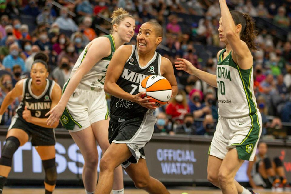 Minnesota Lynx guard Layshia Clarendon drives to the basket past Seattle Storm forward Katie Lou Samuelson and guard Sue Bird in the second quarter of a game Aug. 24 in Minneapolis.