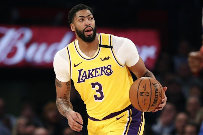 Los Angeles Lakers forward Anthony Davis (3) looks to pass during the first half of an NBA basketball game.