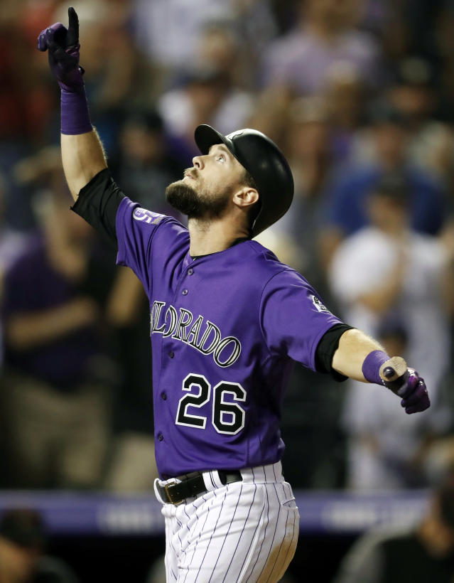 Colorado Rockies' David Dahl gestures as he crosses home plate after hitting a grand slam off Arizona Diamondbacks relief pitcher Matt Andriese in the seventh inning of a baseball game Monday, Sept. 10, 2018, in Denver. (AP Photo/David Zalubowski)