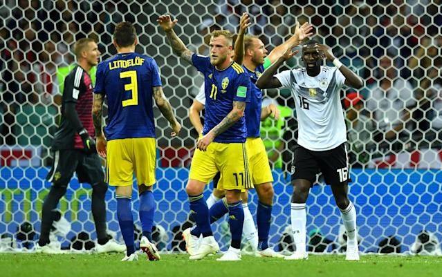 Soccer Football - World Cup - Group F - Germany vs Sweden - Fisht Stadium, Sochi, Russia - June 23, 2018 Sweden's Victor Lindelof and John Guidetti and Germany's Antonio Rudiger react after Julian Brandt (not pictured) hit the post with a shot REUTERS/Dylan Martinez
