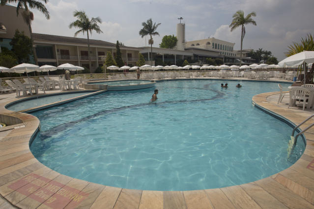 Guests wade in the swimming pool at the Paradise Golf & Lake Resort, the hotel where Belgium's 2014 World Cup team will stay and train during the World Cup in Mogi das Cruzes, Brazil, Friday, Feb. 14, 2014. (AP Photo/Andre Penner)