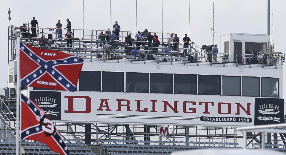 Confederate themed flags fly in the infield before a NASCAR Xfinity auto race at Darlington Raceway in Darlington, S.C., Saturday, Sept. 5, 2015. (AP Photo/Terry Renna)