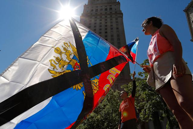 "<p>Demonstrators wave Russian flags as they take part in an anti-Trump ""March for Truth"" rally at Foley Square on June 3, 2017 in New York City. (Photo: Eduardo Munoz Alvarez/Getty Images) </p>"