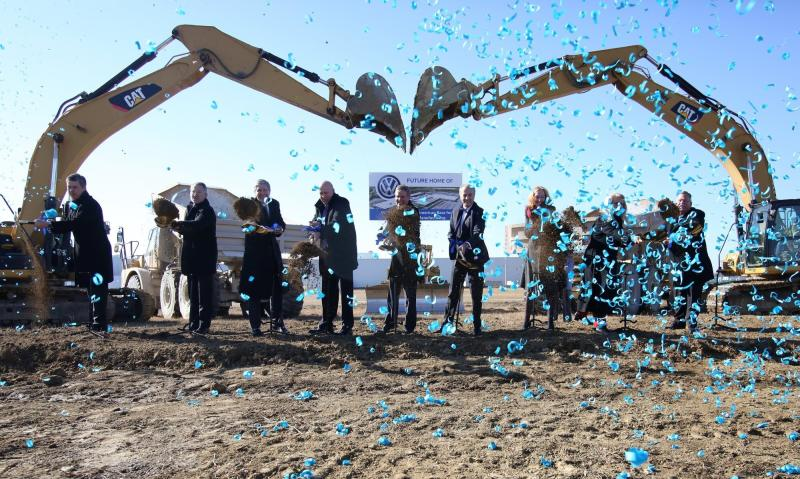 Tennessee officials, Chattanooga officials and Volkswagen officials pose for a photo during the groundbreaking event for the Volkswagen electric vehicle facility at the Volkswagen plant Wednesday, Nov. 13, 2019 in Chattanooga, Tenn. Volkswagen is making Tennessee its North American base for electric vehicle production, breaking ground on an $800 million expansion at the plant in Chattanooga. (Erin O. Smith/Chattanooga Times Free Press via AP)