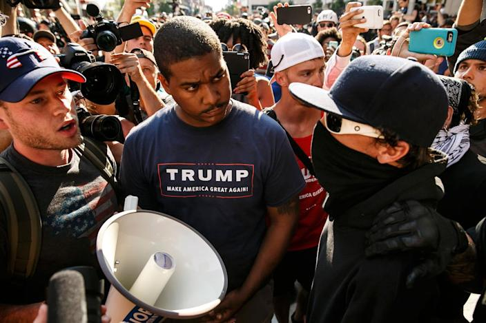 <p>A protester gets into a screaming match with a Trump supporter during the 2016 Republican National Convention in Cleveland on July 19, 2016. (Photo : Marcus Yam/Los Angeles Times via Getty Images)</p>