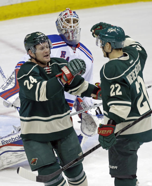 Minnesota Wild's Matt Cooke, left, congratulates teammate Nino Niederreiter, of Switzerland, on his goal off New York Rangers goalie Cam Talbot, background, in the first period of an NHL hockey game on Thursday, March 13, 2014, in St. Paul, Minn. (AP Photo/Jim Mone)