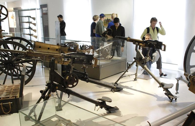 People look at weapons dated from the Franco-Prussian war of 1870-71, displayed at Hotel National des Invalides Army Museum in Paris (AFP Photo/Patrick Kovarik)