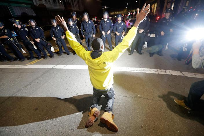 <p>A protester pleads with police Wednesday, Nov. 9, 2016, in Oakland, Calif. Police in Oakland blocked thousands of people protesting Donald Trump's election from getting onto a highway Wednesday night. The crowd chanting and waving signs gathered in Frank Ogawa Plaza in downtown Oakland in the afternoon. (Photo: Marcio Jose Sanchez/AP) </p>