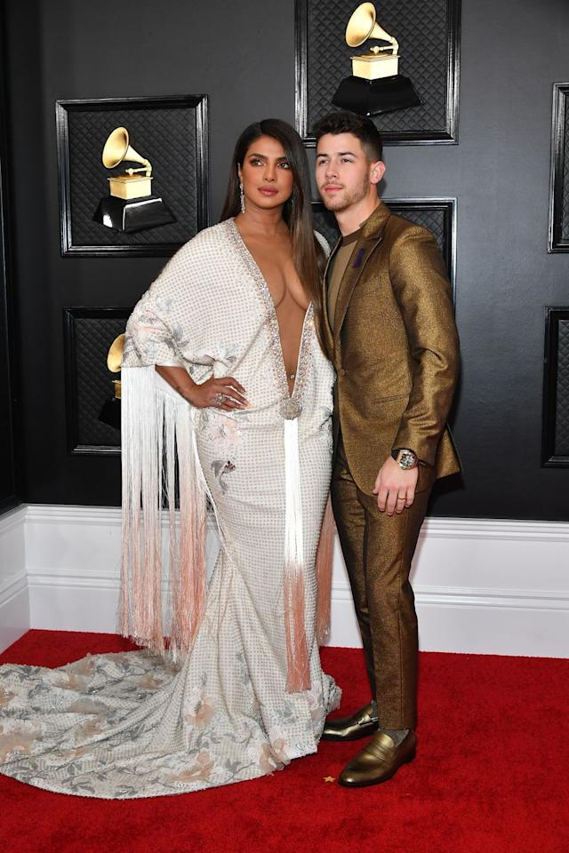<p>Priyanka Chopra channels J.Lo's iconic 2000s Grammys look (y'know, the green dress with the neckline that goes all the way down to her tum?), and absolutely nails it.</p>