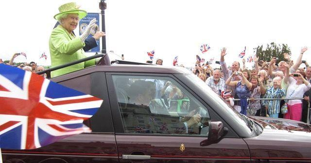 <p>The Queen waving out a car on a visit to Stormont Castle in Belfast during her Diamond Jubilee year of 2012.</p>