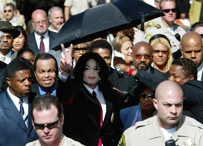 Singer Michael Jackson leaves the courthouse with his father, Joe Jackson (2nd-L) and his mother Katherine Jackson, (R) after his arraignment where he pleaded not guilty to a grand jury indictment of numerous child molestation charges on April 30, 2004 in Santa Maria, California. (Photo by Vince Bucci/Getty Images)