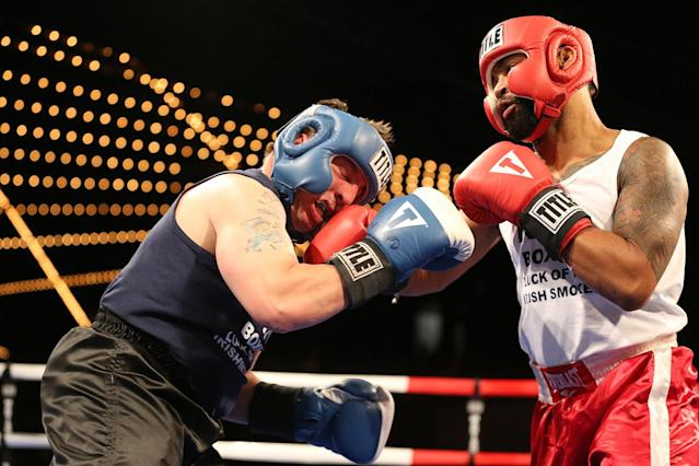 <p>Spiderman, right, connects with a punch on Mike Alba during the NYPD Boxing Championships at the Theater at Madison Square Garden on June 8, 2017. (Photo: Gordon Donovan/Yahoo News) </p>