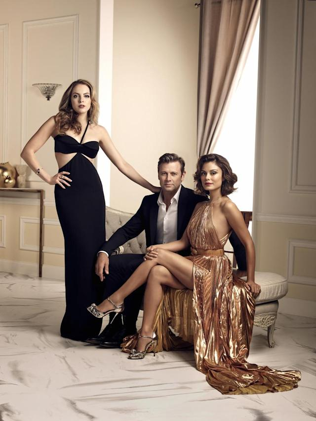 Elizabeth Gillies, Grant Show, and Nathalie Kelley in <em>Dynasty</em>. (Photo: Christopher Fragapane/The CW)