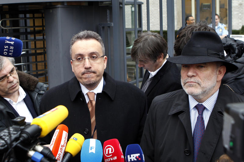 Lawyer Luka Misetic, left, and Gotovina's American lawyer, Greg Kehoe, right, talk to the media outside the Yugoslav war crimes tribunal (ICTY) in The Hague, Netherlands, Friday, Nov. 16, 2012. The ICTY appeals judges overturned the convictions of two Croat generals on Friday for crimes against humanity and war crimes committed against Serb civilians in a 1995 military blitz. The decision, by a 3-2 majority in the five judge appeals chamber, is one of the most significant reversals in the court's 18-year history and overturns a verdict that dealt a blow to Croatia's self-image as a victim of atrocities, rather than a perpetrator, during the Balkan wars in the 1990s. (AP Photo/Bas Czerwinski)