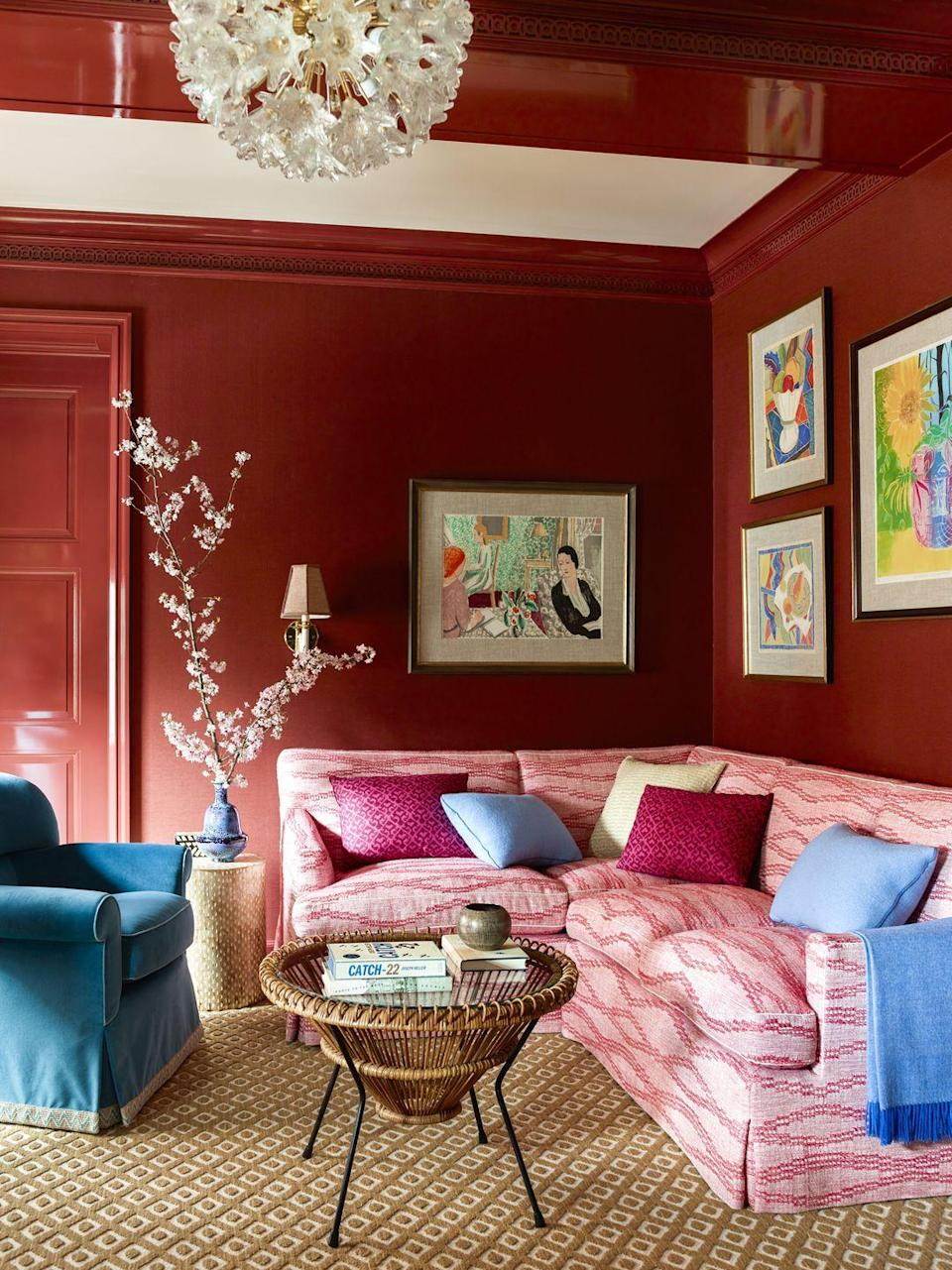 """<p>Just avoid super-bright reds and your house won't look like a fire station. A richer shade of crimson warms up this space by <a href=""""https://www.katieridder.com/"""" rel=""""nofollow noopener"""" target=""""_blank"""" data-ylk=""""slk:Katie Ridder"""" class=""""link rapid-noclick-resp"""">Katie Ridder</a>, while contrasting furniture in pinks and blues helps break up the bold hue. </p>"""