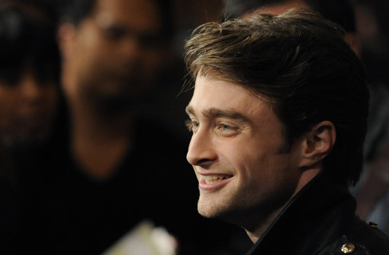 """FILE - This is a Thursday, Feb. 2, 2012 file photo of British actor Daniel Radcliffe, star of the supernatural thriller """"The Woman in Black,"""" as he is interviewed at the premiere of the film in Los Angeles. Daniel Radcliffe has won magical reviews for his latest stage role as a disabled Irish dreamer in Martin McDonagh's """"The Cripple of Inishmaan."""" The former """"Harry Potter"""" star plays the title role in a Michael Grandage-directed production of McDonagh's scabrous tragicomedy at London's Noel Coward Theatre. (AP Photo/Chris Pizzello, File)"""